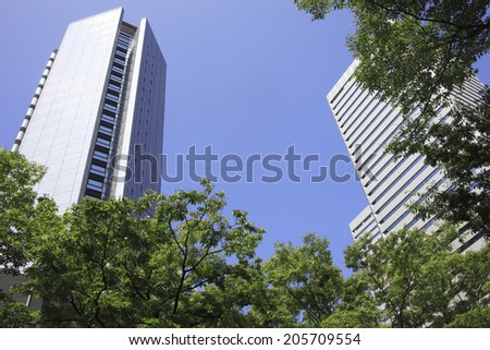 Trees And High-Rise Building - stock photo