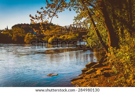 Trees and train bridge over the Potomac River in Harper's Ferry, West Virginia. - stock photo