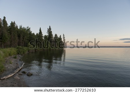 Trees at the lakeside, Lake Audy Campground, Riding Mountain National Park, Manitoba, Canada - stock photo