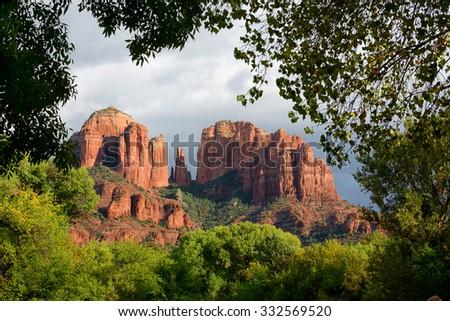 Trees framing cathedral rock vortex in sedona, arizona - stock photo