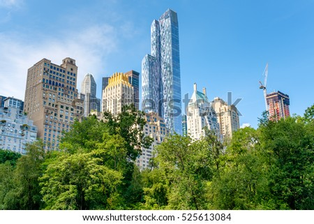 Trees in Central Park with a view of the Central Park South skyline in midtown Manhattan, New York City