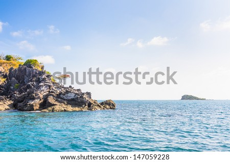 Trees on cliff, blue sky with cloud, Nam Du islands, Kien Giang province, Vietnam - stock photo
