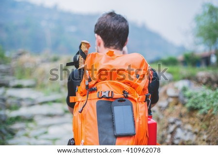 Trekker backpack with solar panel - stock photo