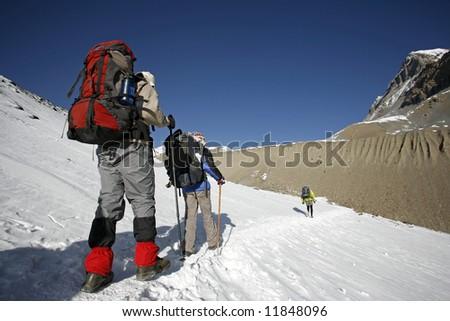 trekkers following path the mountain summit - stock photo