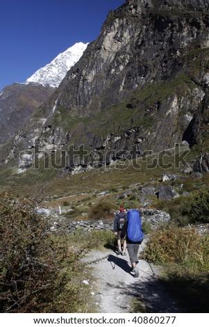 Trekkers walking in the Langtang region Nepal. - stock photo