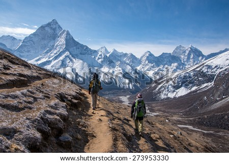 Trekkers walking on the way to Everest base camp, Nepal - stock photo