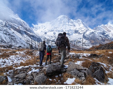 Trekkers walking to Annapurna Sanctuary, Himalayas, Nepal - stock photo