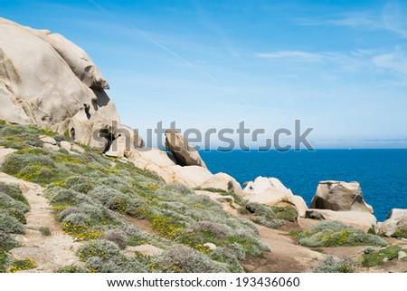 Trekking along the coast in Capo Testa, Santa Teresa di Gallura, Sardinia, Italy - stock photo