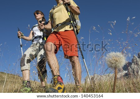 Trekking and nordic walking in the Dolomite - stock photo