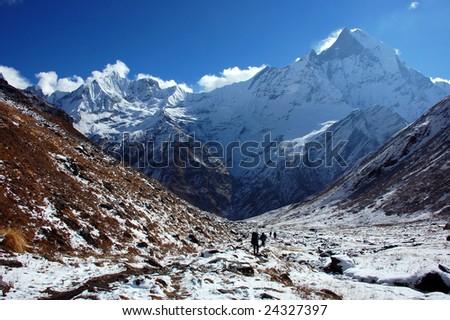 Trekking at the Foot of Machapuchare (Annapurna, Nepal) - stock photo