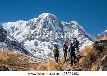 Trekking in Annapurna region, with Annapurna South in background, Nepal
