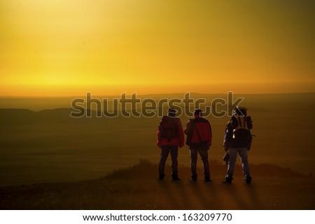 Trekking mountains greet morning sun stock photo royalty free trekking in mountains greet the morning sun m4hsunfo