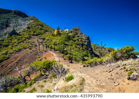 trekking path to the top of the highest mountain of Madeira - Pico Ruivo, Portugal - stock photo