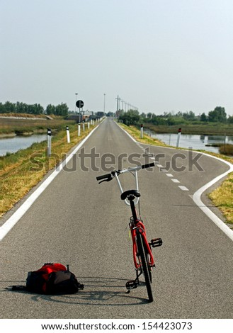 trekking red bike for a ride in the middle of the Venetian Lagoon near Venice