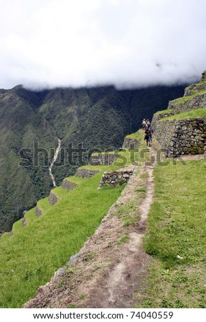 Trekking the inca trail along the ancient stone pathways - stock photo