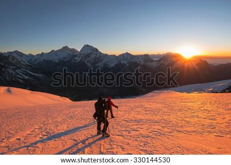 Trekking to Mera Peak at sunrise - stock photo