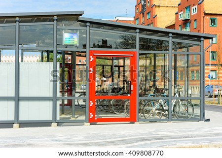 Trelleborg, Sweden - April 12, 2016: Bicycle garage near the railway station, for parking the bikes in a more protected environment. A red door saying out in Swedish. - stock photo