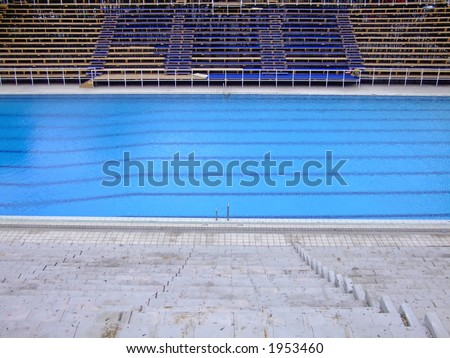 trembling surface of an olympic size swimming pool in empty sport arena - Olympic Size Swimming Pool