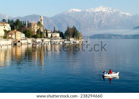 Tremezzo, Italy - 8 January 2005:People on a rowing boat at the coast of lake Como near Tremezzo on Italy