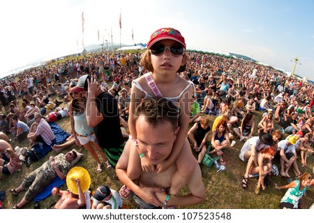 TRENCIN,SLOVAKIA - JULY 7:Little girl at the Pohoda Music Festival at the Trencin Airport in Trencin, Slovakia on July 7, 2012. - stock photo