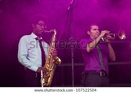 TRENCIN,SLOVAKIA - JULY 6: Saxophonist and trumpetist of Aloe Blacc's group performs at the Bazant Pohoda Music Festival at the Trencin Airport in Trencin, Slovakia on July 6, 2012.