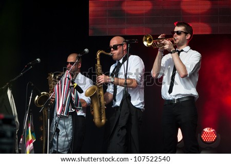 TRENCIN,SLOVAKIA - JULY 6: The Heavy's brass section performs at the Bazant Pohoda Music Festival at the Trencin Airport in Trencin, Slovakia on July 6, 2012.