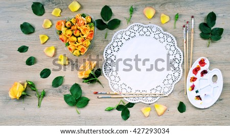 trend arrangement .top view of the heart of flowers ,flat lay floral ,on wooden background with space for text or invitation - stock photo