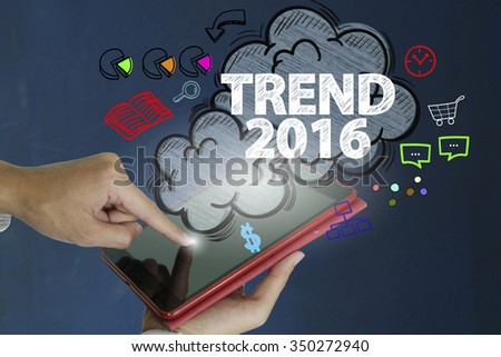 TREND 2016 over a tablet computer on dark blue background , business concept , business idea - stock photo