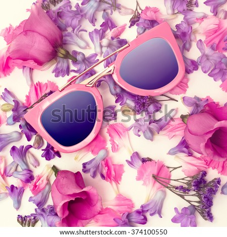 Trend Sunglasses on Flowers background. Summer is coming.