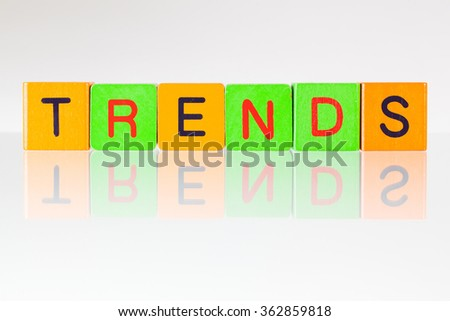 Trends - an inscription from children's wooden blocks - stock photo