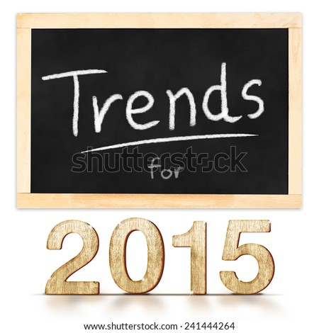Trends for 2015 on blackboard in white background - stock photo