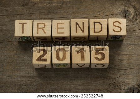 Trends for 2015 text on a wooden background - stock photo