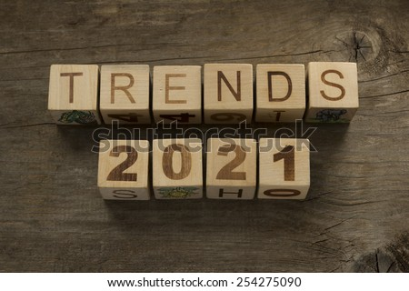 Trends for 2021 text on a wooden background - stock photo