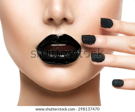 Trendy Black Caviar Manicure and Black Lips. Beauty Fashion Makeup and Manicure. Glamour Nail Art and Make up closeup - stock photo