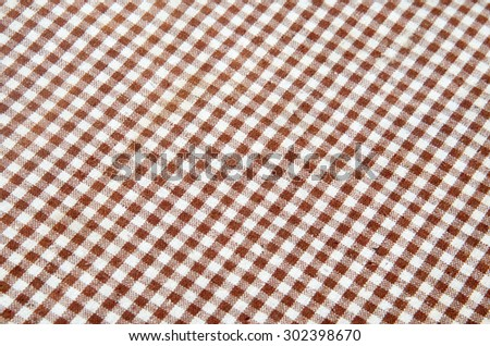 Trendy checkered gingham textile of brown color  - stock photo