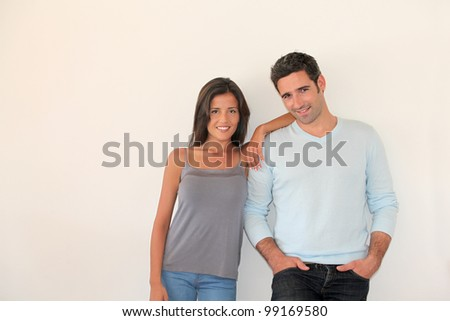 Trendy couple standing on white background - stock photo