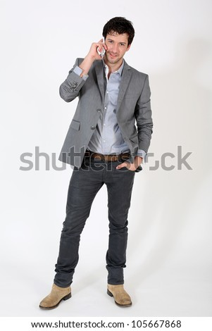 Trendy guy talking on mobile phone - stock photo