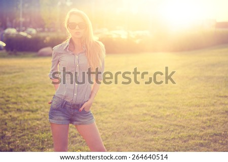 Trendy Hipster Girl in the City at Sunset. Urban Fashion Concept. Toned and Filtered Photo. Copy Space. - stock photo