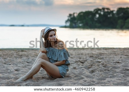 Trendy Hipster Girl Relaxing on the beach