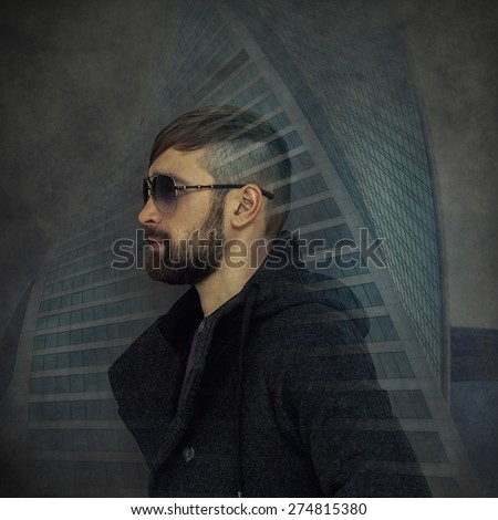 Trendy man with a beard and sunglasses on the background of the modern skyscraper. Double exposure, photo collage.