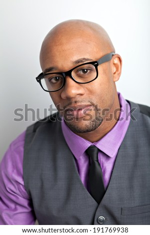 Trendy modern business man wearing black framed glasses. - stock photo