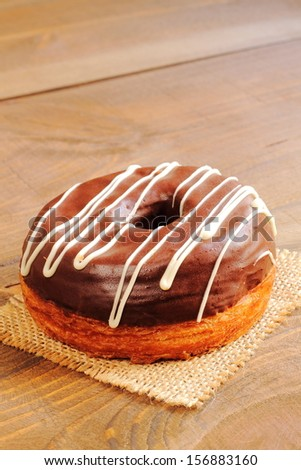 Trendy puff pastries, half croissant and half donut - stock photo