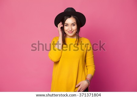Trendy sexy young female wearing casual clothes posing over pink background - stock photo