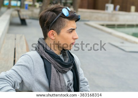 trendy teenager boy with sunglasses outdoors - stock photo