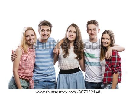 Trendy teenagers posing. Studio shot on white background - stock photo