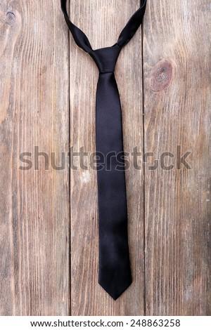 Trendy tie on wooden planks background - stock photo