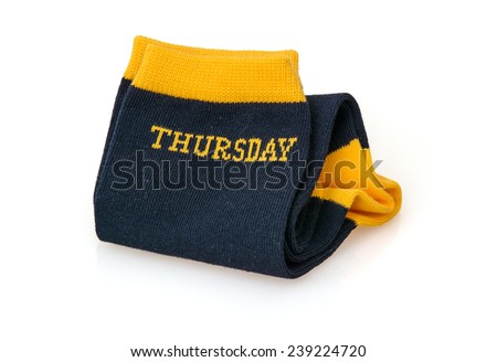 Trendy wool socks with inscription THURSDAY isolated on a white background. - stock photo