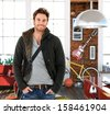Trendy young man at home, smiling. - stock photo