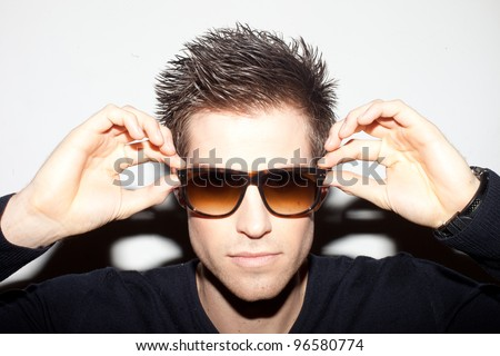 Spiky hair stock images royalty free images vectors shutterstock trendy young man with spiky hair with his hands raised to a pair of sunglasses urmus Image collections