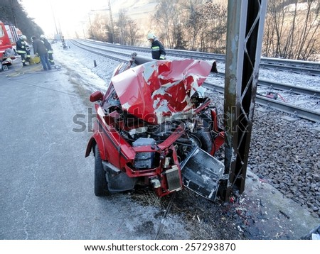 TRENTO, ITALY - MARCH 1, 2015: Dramatic scene of a terrible fatal accident with a car collided with a pole electric railroad. Unknown car destroyed against an electricity pylon on march 1, 2015